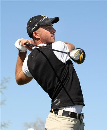SCOTTSDALE, AZ - FEBRUARY 01:  Geoff Ogilvy of Australia hits his tee shot on the ninth hole during the final round of the FBR Open on February 1, 2009 at TPC Scottsdale in Scottsdale, Arizona.  (Photo by Stephen Dunn/Getty Images)