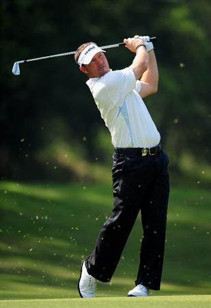 SHENZHEN, GUANGDONG - NOVEMBER 24:  Alex Cejka of Germany plays a shot during practice for the Omega Mission Hills World Cup on the Olazabal course on November 24, 2009 in Shenzhen, China.  (Photo by Stuart Franklin/Getty Images)
