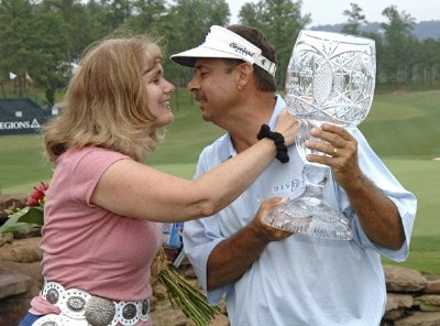 Brad Bryant receives a kiss from wife, Sue, after winning the Regions Charity Classic held at Robert Trent Jones Golf Trail at Ross Bridge in Birmingham, Alabama, on May 7, 2006.Photo by Al Messerschmidt/WireImage.com