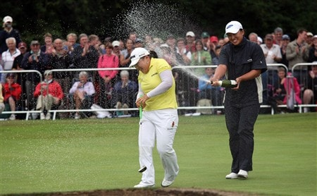 SUNNINGDALE, UNITED KINGDOM - AUGUST 03: Ji-Yai Shin of South Korea is sprayed with champagne on the 18th green after holing the winning putt by fellow Korean golfer Amy Yang during the final round of the 2008  Ricoh Women's British Open Championship held on the Old Course at Sunningdale Golf Club, on August 3, 2008 in Sunningdale, England.  (Photo by David Cannon/Getty Images)