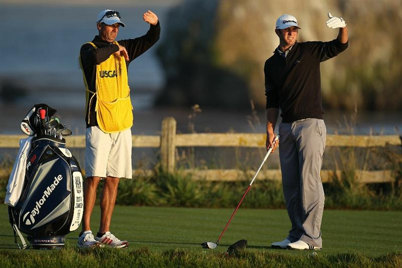 PEBBLE BEACH, CA - JUNE 19:  Dustin Johnson chats with his caddie Bobby Brown on the 18th tee during the third round of the 110th U.S. Open at Pebble Beach Golf Links on June 19, 2010 in Pebble Beach, California.  (Photo by Ross Kinnaird/Getty Images)