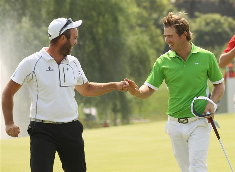 CHENGDU, CHINA - APRIL 24:  Pablo Martin of Spain celebrates Eigth with Christian  Nilsson of Sweden during day four of the Volvo China Open at Luxehills Country Club on April 24, 2011 in Chengdu, China.  (Photo by Ian Walton/Getty Images)
