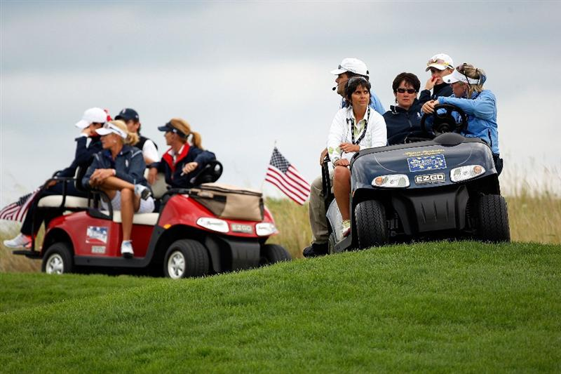 SUGAR GROVE, IL - AUGUST 22:  Members of both the U.S. Team and The European Team captains watch play along the 11th fairway during the Saturday afternoon Foursomes matches at the 2009 Solheim Cup at Rich Harvest Farms on August 22, 2009 in Sugar Grove, Illinois.  (Photo by Chris Graythen/Getty Images)