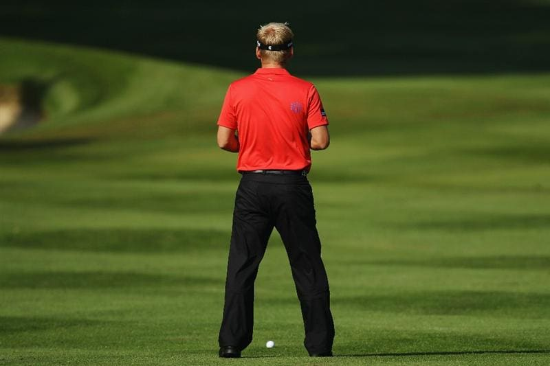 VIRGINIA WATER, ENGLAND - MAY 21:  Soren Kjeldsen of Denmark prepares to play an iron shot during the second round of the BMW PGA Championship on the West Course at Wentworth on May 21, 2010 in Virginia Water, England.  (Photo by Ross Kinnaird/Getty Images)