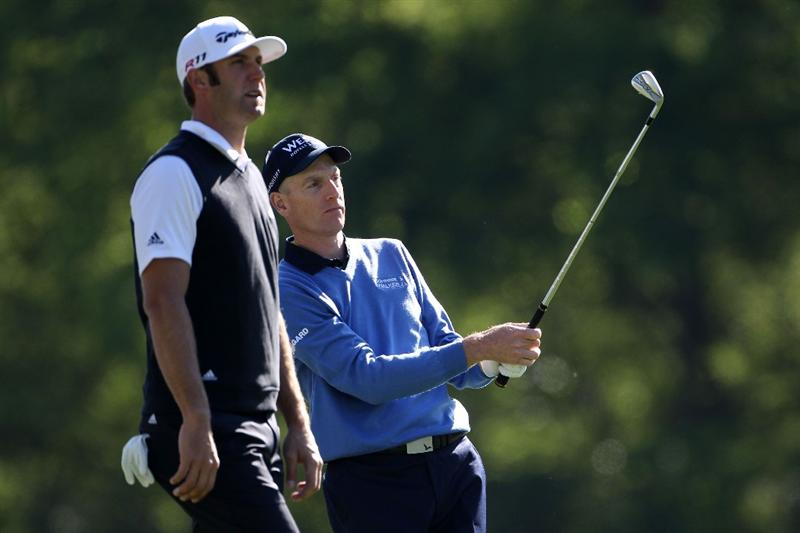 AUGUSTA, GA - APRIL 06:  Jim Furyk watches a shot as Dustin Johnson look on during a practice round prior to the 2011 Masters Tournament at Augusta National Golf Club on April 6, 2011 in Augusta, Georgia.  (Photo by Jamie Squire/Getty Images)