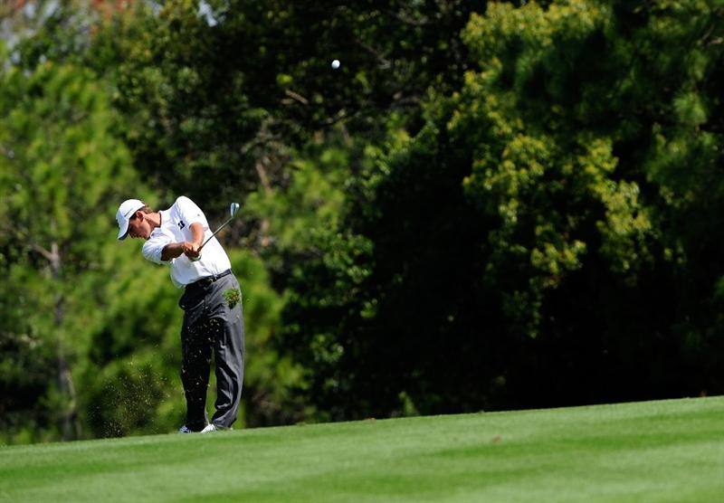PALM HARBOR, FL - MARCH 20:  Charles Howell III hits a shot on the 7th hole during the second round of the Transitions Championship at the Innisbrook Resort and Golf Club on March 20, 2009 in Palm Harbor, Florida.  (Photo by Sam Greenwood/Getty Images)