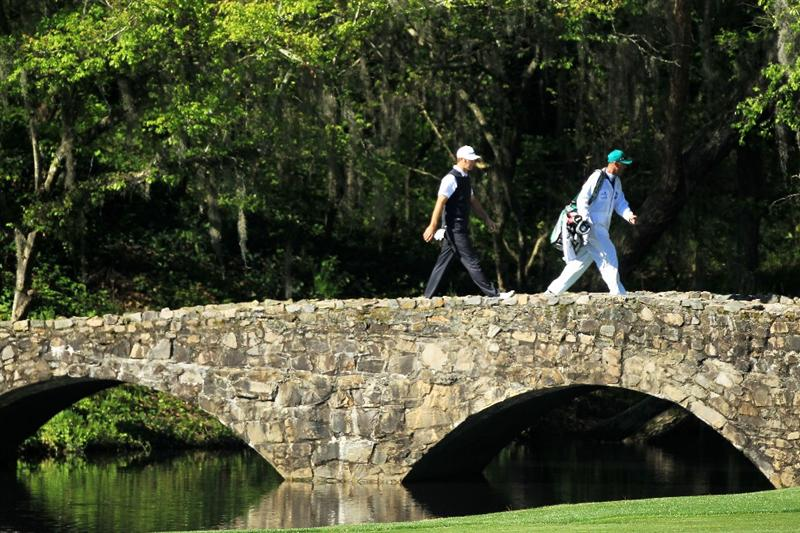 AUGUSTA, GA - APRIL 06:  Dustin Johnson walks across the Nelson Bridge with his caddie Bobby Brown during a practice round prior to the 2011 Masters Tournament at Augusta National Golf Club on April 6, 2011 in Augusta, Georgia.  (Photo by David Cannon/Getty Images)
