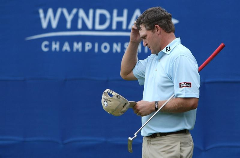 GREENSBORO, NC - AUGUST 23:  Jason Bohn reacts to missing a putt on the 18th hole during the final round of the Wyndham Championship at Sedgefield Country Club on August 23, 2009 in Greensboro, North Carolina.  (Photo by Streeter Lecka/Getty Images)