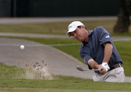 Rich Beem blasts from the sand  during first-round competition March 3, 2005  at the Ford Championship at Doral in Miami.