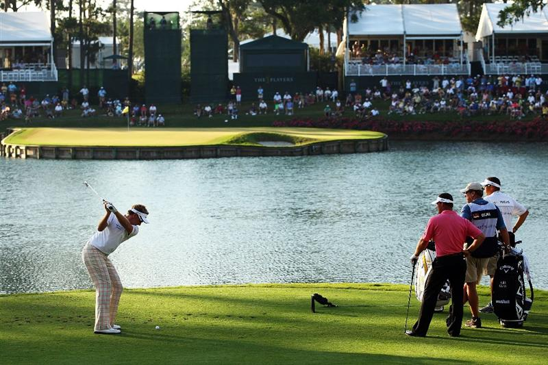 PONTE VEDRA BEACH, FL - MAY 09:  Ian Poulter of England his his tee shot on the 17th hole as Alex Cejka looks on during the third round of THE PLAYERS Championship on THE PLAYERS Stadium Course at TPC Sawgrass on May 9, 2009 in Ponte Vedra Beach, Florida.  (Photo by Scott Halleran/Getty Images)