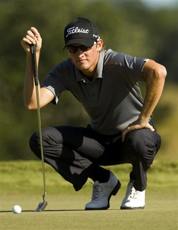 CHARLESTON, SC - OCTOBER 22:  Michael Sim lines up a putt on the 14th hole during the first round of the Nationwide Tour Championship at Daniel Island on October 22, 2009 in Charleston, South Carolina. (Photo by Chris Keane/Getty Images)