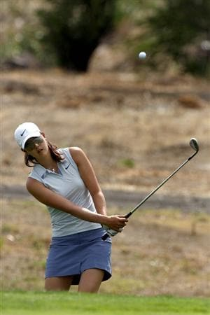 MORELIA, MEXICO- APRIL 23:  Michelle Wie hits out of the rough on the 4th hole  during the first round of the 2009 Corona Championship, part of the LPGA Tour, on April 23, 2009 at the Tres Marias Golf Club in Morelia, Michoacan, Mexico. (Photo by Donald Miralle/Getty Images)