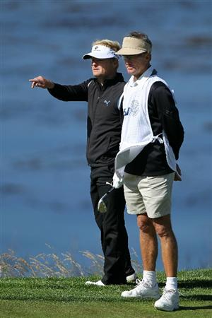 PEBBLE BEACH, CA - JUNE 17:  Soren Kjeldsen of Denmark chats with his caddie on the ninth hole as his caddie Kevin Woodward looks on during the first round of the 110th U.S. Open at Pebble Beach Golf Links on June 17, 2010 in Pebble Beach, California.  (Photo by Donald Miralle/Getty Images)