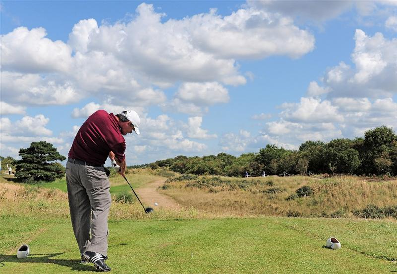 ZANDVOORT, NETHERLANDS - AUGUST 22:  Paul Lawrie of Scotland plays his tee shot on the second hole during the third round of The KLM Open at Kennemer Golf & Country Club on August 22, 2009 in Zandvoort, Netherlands.  (Photo by Stuart Franklin/Getty Images)