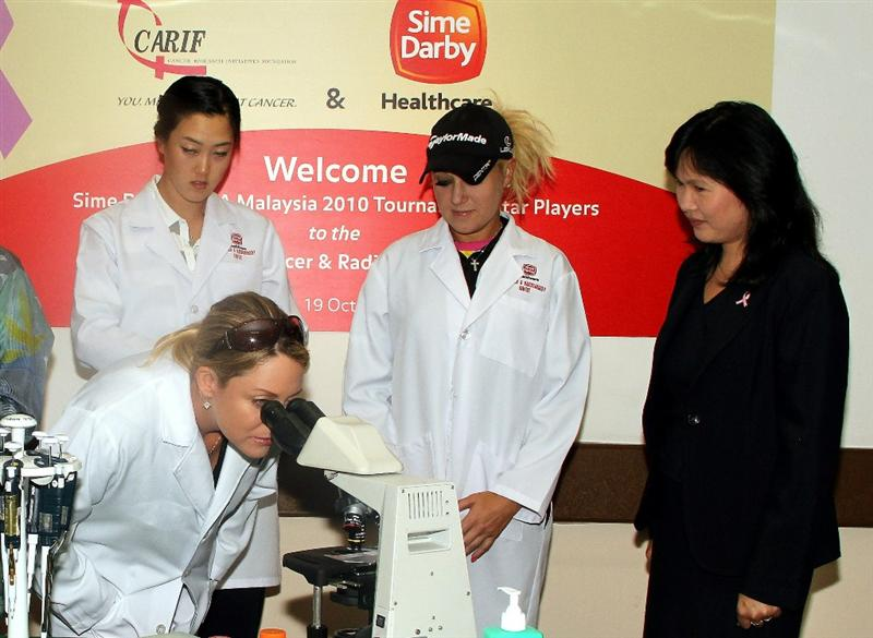 KUALA LUMPUR, MALAYSIA - OCTOBER 19 : Michelle Wie, Cristie Kerr, Natalie Gulbis of USA and Prof. Dr Teo Soo-Hwang of the Subang Medical Centre attend the Sime Darby LPGA Charity visit to the Subang Medical Centre on October 19, 2010 in Kuala Lumpur, Malaysia (Photo by Stanley Chou/Getty Images)