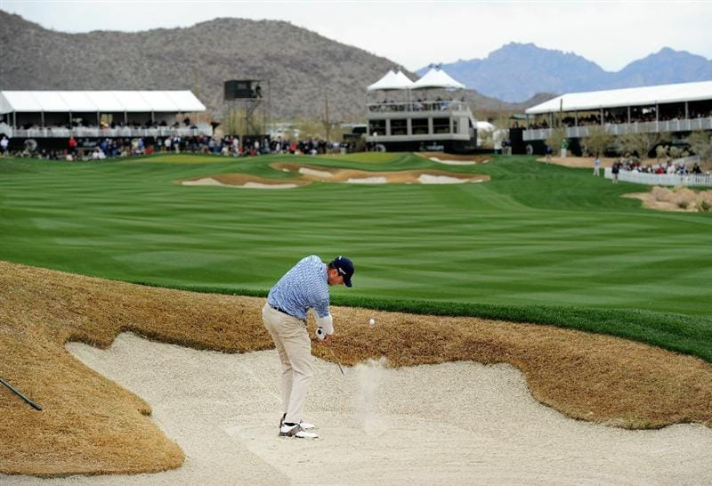 MARANA, AZ - FEBRUARY 26:  Matt Kuchar hits out of a bunker on the 13th hole during the semifinal round of the Accenture Match Play Championship at the Ritz-Carlton Golf Club on February 26, 2011 in Marana, Arizona.  (Photo by Stuart Franklin/Getty Images)