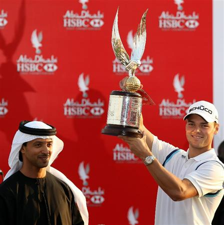 ABU DHABI, UNITED ARAB EMIRATES - JANUARY 23:  Martin Kaymer of Germany is presented with the trophy by His Highness Sheikh Hazza Bin Zayed Al Nahyan The National Security Advisor, Vice Chairman of the Executive Council, and Chairman of the Abu Dhabi Sports Council after winning the 2011 Abu Dhabi HSBC Golf Championship held at the Abu Dhabi Golf Club on January 23, 2011 in Abu Dhabi, United Arab Emirates.  (Photo by Ross Kinnaird/Getty Images)