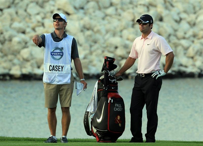 BAHRAIN, BAHRAIN - JANUARY 30:  Paul Casey of England with his caddie Christian Donald of England before he plays his second shot at the 18th hole during the final round of the 2011 Volvo Champions held at the Royal Golf Club on January 30, 2011 in Bahrain, Bahrain.  (Photo by David Cannon/Getty Images)