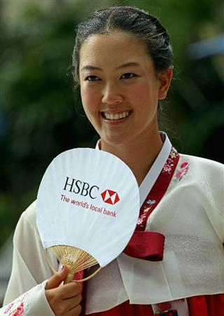 SINGAPORE - FEBRUARY 22:  Michelle Wie of the USA wears traditional Korean dress during a photocall at the Fairmont Hotel prior to the start of the HSBC Women's Champions at the Tanah Merah Country Club on February 22, 2011 in Singapore.  (Photo by Andrew Redington/Getty Images)