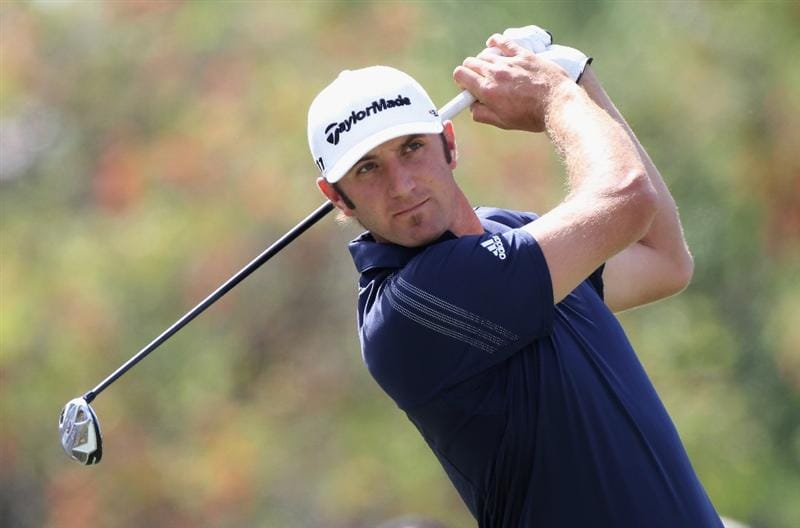 DORAL, FL - MARCH 12:  Dustin Johnson hits his tee shot on the fifth hole during the third round of the 2011 WGC- Cadillac Championship at the TPC Blue Monster at the Doral Golf Resort and Spa on March 12, 2011 in Doral, Florida.  (Photo by Sam Greenwood/Getty Images)