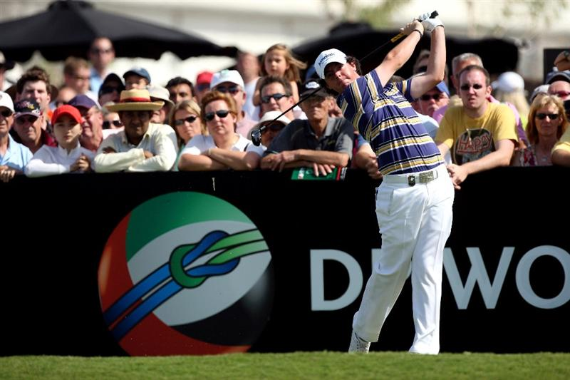 DUBAI, UNITED ARAB EMIRATES - NOVEMBER 21:  Rory McIlroy of Northern Ireland plays his tee shot at the 1st hole during the third round of the Dubai World Championship, on the Earth Course, Jumeirah Golf Estates on November 21, 2009 in Dubai, United Arab Emirates  (Photo by David Cannon/Getty Images)
