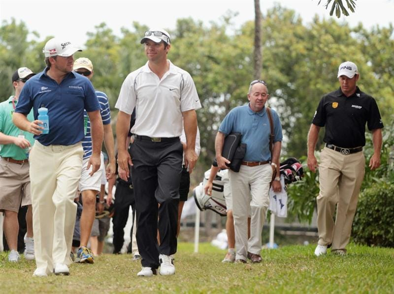 DORAL, FL - MARCH 10:  (R-L) Graeme McDowell of Northern Ireland,  Paul Casey and Lee Westwood of England walk off the practice ground after play was suspended due to dangerous weather during the first round of the 2011 WGC- Cadillac Championship at the TPC Blue Monster at the Doral Golf Resort and Spa on March 10, 2011 in Doral, Florida.  (Photo by Scott Halleran/Getty Images)