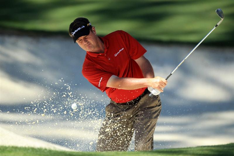 AUGUSTA, GA - APRIL 09:  Todd Hamilton plays a bunker shot on the tenth hole during the second round of the 2010 Masters Tournament at Augusta National Golf Club on April 9, 2010 in Augusta, Georgia.  (Photo by David Cannon/Getty Images)