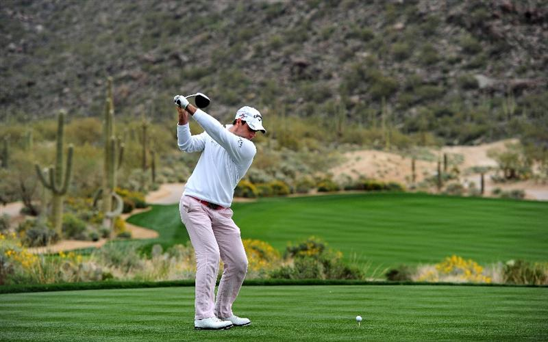 MARANA, AZ - FEBRUARY 20:  Oliver Wilson of England plays his tee shot on the 14th hole during round four of the Accenture Match Play Championship at the Ritz-Carlton Golf Club on February 20, 2010 in Marana, Arizona.  (Photo by Stuart Franklin/Getty Images)