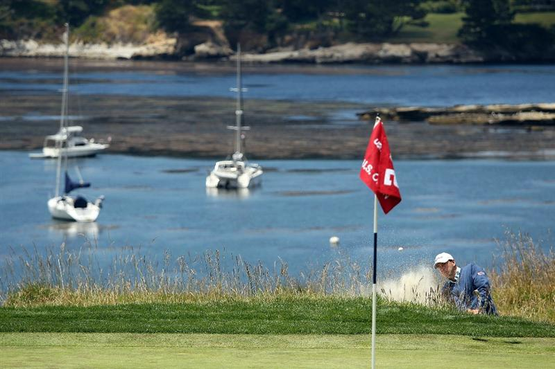 PEBBLE BEACH, CA - JUNE 19:  Ben Curtis hits from a bunker on the fourth green during the third round of the 110th U.S. Open at Pebble Beach Golf Links on June 19, 2010 in Pebble Beach, California.  (Photo by Ross Kinnaird/Getty Images)