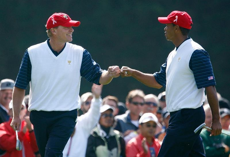 SAN FRANCISCO - OCTOBER 09:  Steve Stricker and Tiger Woods of the USA Team celebrate on the first green during the Day Two Fourball Matches of The Presidents Cup at Harding Park Golf Course on October 9, 2009 in San Francisco, California.  (Photo by Scott Halleran/Getty Images)