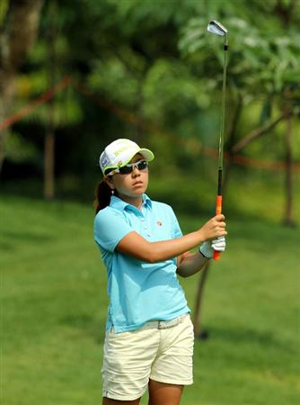 KUALA LUMPUR, MALAYSIA - OCTOBER 23 : Mika Miyazato of Japan watches her 2nd shot on the 1st hole during Round Two of the Sime Darby LPGA on October 23, 2010 at the Kuala Lumpur Golf and Country Club in Kuala Lumpur, Malaysia. (Photo by Stanley Chou/Getty Images)