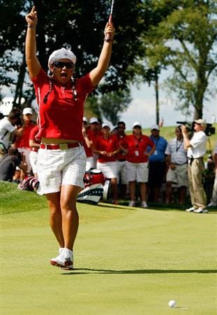 SUGAR GROVE, IL - AUGUST 23:  Christina Kim of the U.S. Team celebrates as her birdie putt falls on the 16th green during the Sunday singles matches at the 2009 Solheim Cup at Rich Harvest Farms on August 23, 2009 in Sugar Grove, Illinois.  (Photo by Chris Graythen/Getty Images)