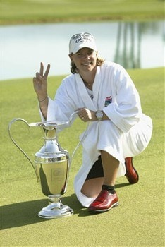 31 Mar 2002:   Annika Sorenstam poses the trophy and wears the white robe of the champion after the final round of the Kraft Nabisco Championship at Mission Hills Country Club in Rancho Mirage, California.  DIGITAL IMAGE  Mandatory Credit:   Stephen Dunn/Getty Images