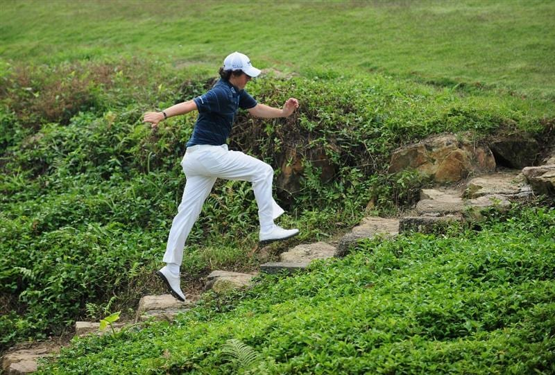 SHENZHEN, GUANGDONG - NOVEMBER 27:  Rory McIlroy of Ireland runs up some steps during Foursomes on the second day of the Omega Mission Hills World Cup on the Olazabal course on November 27, 2009 in Shenzhen, China.  (Photo by Stuart Franklin/Getty Images)