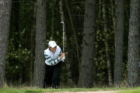 HALMSTAD, SWEDEN - SEPTEMBER 14:  Catriona Matthew  hits out of the trees on the 11th during the morning foursomes at the Solheim Cup at Halmstad Golf Club on September 14, 2007 in Halmstad, Sweden.  (Photo by Jonathan Ferrey/Getty Images)