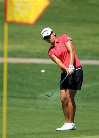 RANCHO MIRAGE, CA - APRIL 03:  Yani Tseng of Taiwan plays her third shot on the par 5, 2nd hole during the final round of the 2011 Kraft Nabisco Championship on the Dinah Shore Championship Course at the Mission Hills Country Club on April 3, 2011 in Rancho Mirage, California.  (Photo by David Cannon/Getty Images)