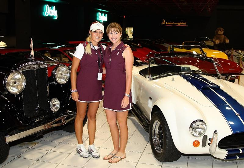 SUGAR GROVE, IL - AUGUST 17:  (L-R), Natalie Gulbis and Paula Creamer of the U.S. Solheim team pose inside the car museum on the grounds of Rich Harvest Farms, host site of the 2009 Solheim Cup on August 17, 2009 in Sugar Grove, Illinois.  (Photo by David Cannon/Getty Images)