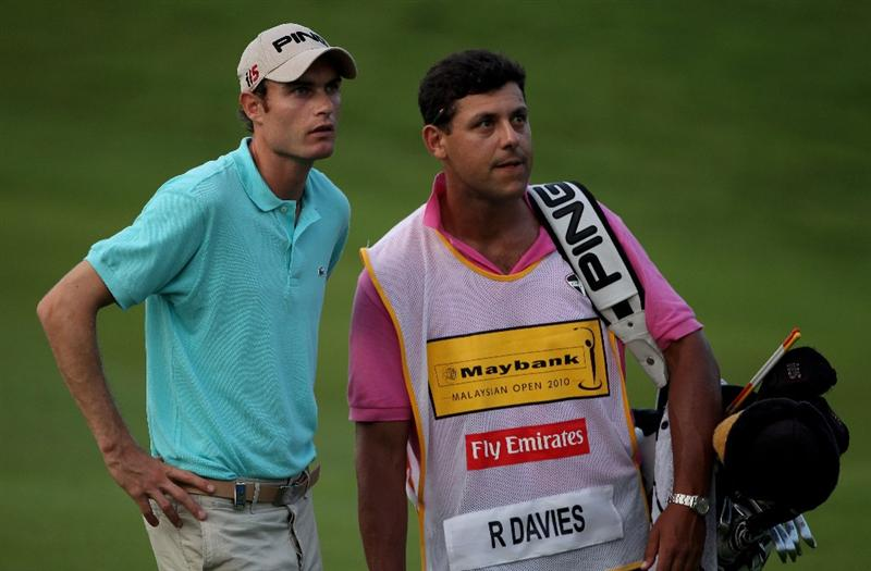 KUALA LUMPUR, MALAYSIA - MARCH 05:  Rhys Davies of Wales waits with his caddie on the 18th hole during the second round of the Maybank Malaysia Open at the Kuala Lumpur Golf & Country on March 5, 2010 in Kuala Lumpur, Malaysia.  (Photo by Ross Kinnaird/Getty Images)