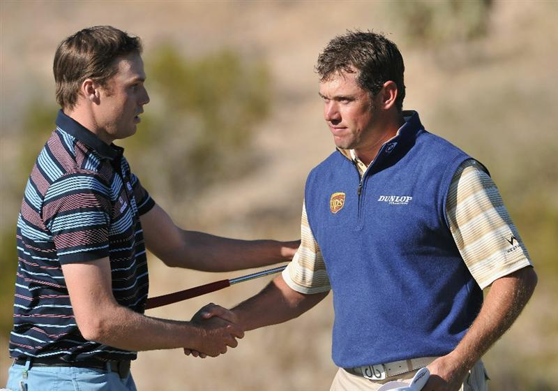 MARANA, AZ - FEBRUARY 24:  Nick Watney and  Lee Westwood of England shake hands on the 18th hole during the second round of the Accenture Match Play Championship at the Ritz-Carlton Golf Club on February 24, 2011 in Marana, Arizona.  (Photo by Stuart Franklin/Getty Images)