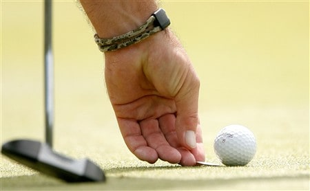 HILTON HEAD, SC - APRIL 19:  Boo Weekley marks his ball on the fifth hole during the third round of the Verizon Heritage at Harbour Town Golf Links April 19, 2008 in Hilton Head, South Carolina.  (Photo by Streeter Lecka/Getty Images)