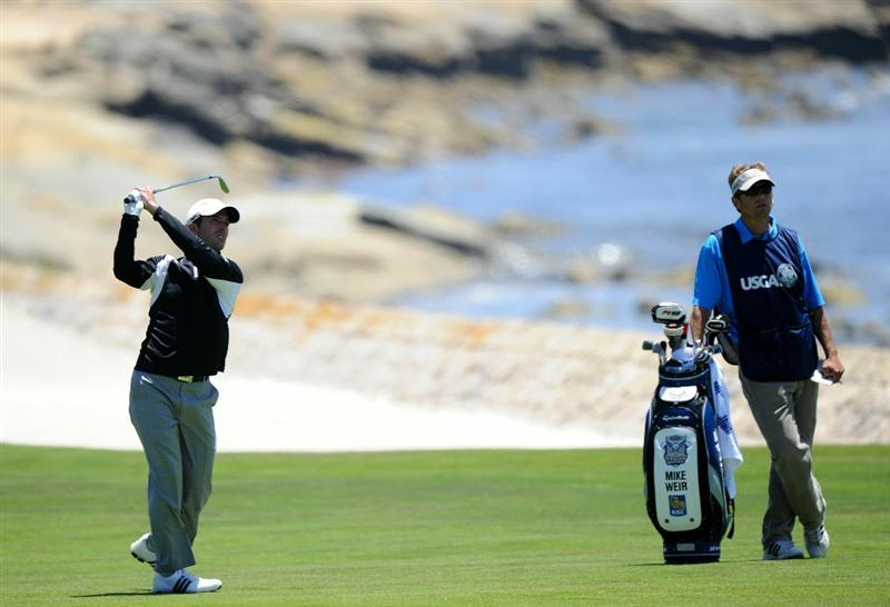PEBBLE BEACH, CA - JUNE 17:  Mike Weir of Canada hits a shot to the 18th green as his caddie Brendon Little looks on during the first round of the 110th U.S. Open at Pebble Beach Golf Links on June 17, 2010 in Pebble Beach, California.  (Photo by Harry How/Getty Images)