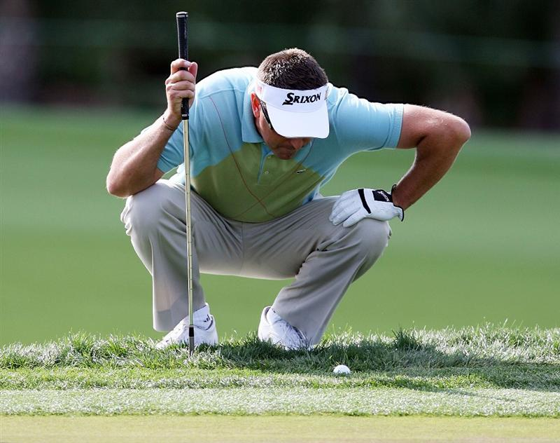 PALM BEACH GARDENS, FL - MARCH 07:  Robert Allenby gets a close look at the lie of his ball on the ninth hole during the third round of The Honda Classic at PGA National Resort and Spa on March 7, 2009 in Palm Beach Gardens, Florida.  (Photo by Doug Benc/Getty Images)