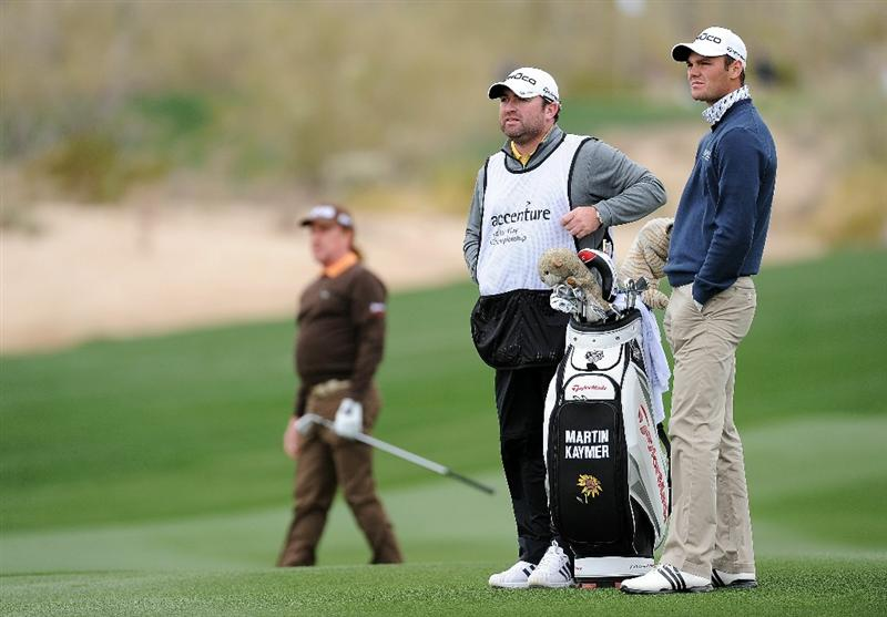 MARANA, AZ - FEBRUARY 26:  Miguel Angel Jimenez of Spain (L) watches his approach shot on the seventh hole as Martin Kaymer of Germany (R) and caddie Craig Connelly (C) look on during the quarterfinal round of the Accenture Match Play Championship at the Ritz-Carlton Golf Club on February 26, 2011 in Marana, Arizona.  (Photo by Stuart Franklin/Getty Images)
