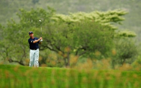 MALELANE, SOUTH AFRICA - DECEMBER 07:  Darren Clarke of Northern Ireland plays his second shot into the third green during the second round of The Alfred Dunhill Championship at The Leopard Creek Country Club on December 7, 2007 in Malelane, South Africa.  (Photo by Warren Little/Getty Images)