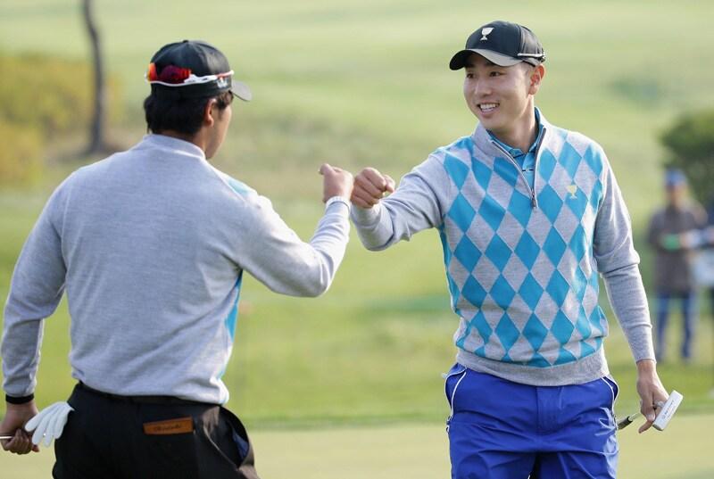 Hideki Matsuyama and Sangmoon Bae