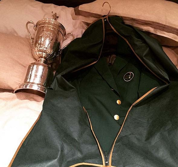 Jordan Spieth introduces his U.S. Open trophy to his green jacket