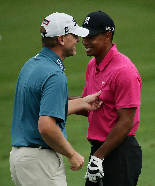 Steve Stricker greeting Tiger Woods with a nipple grab ... or