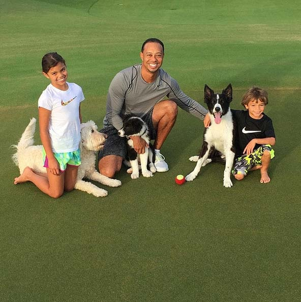 Tiger Woods with his kids and new dog