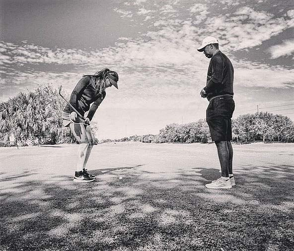Michelle Wie and Tiger Woods