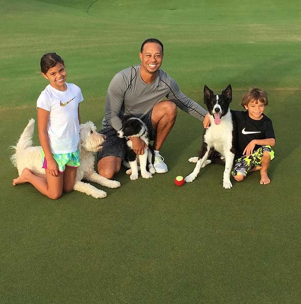 Tiger, Sam and Charlie Woods with their dogs